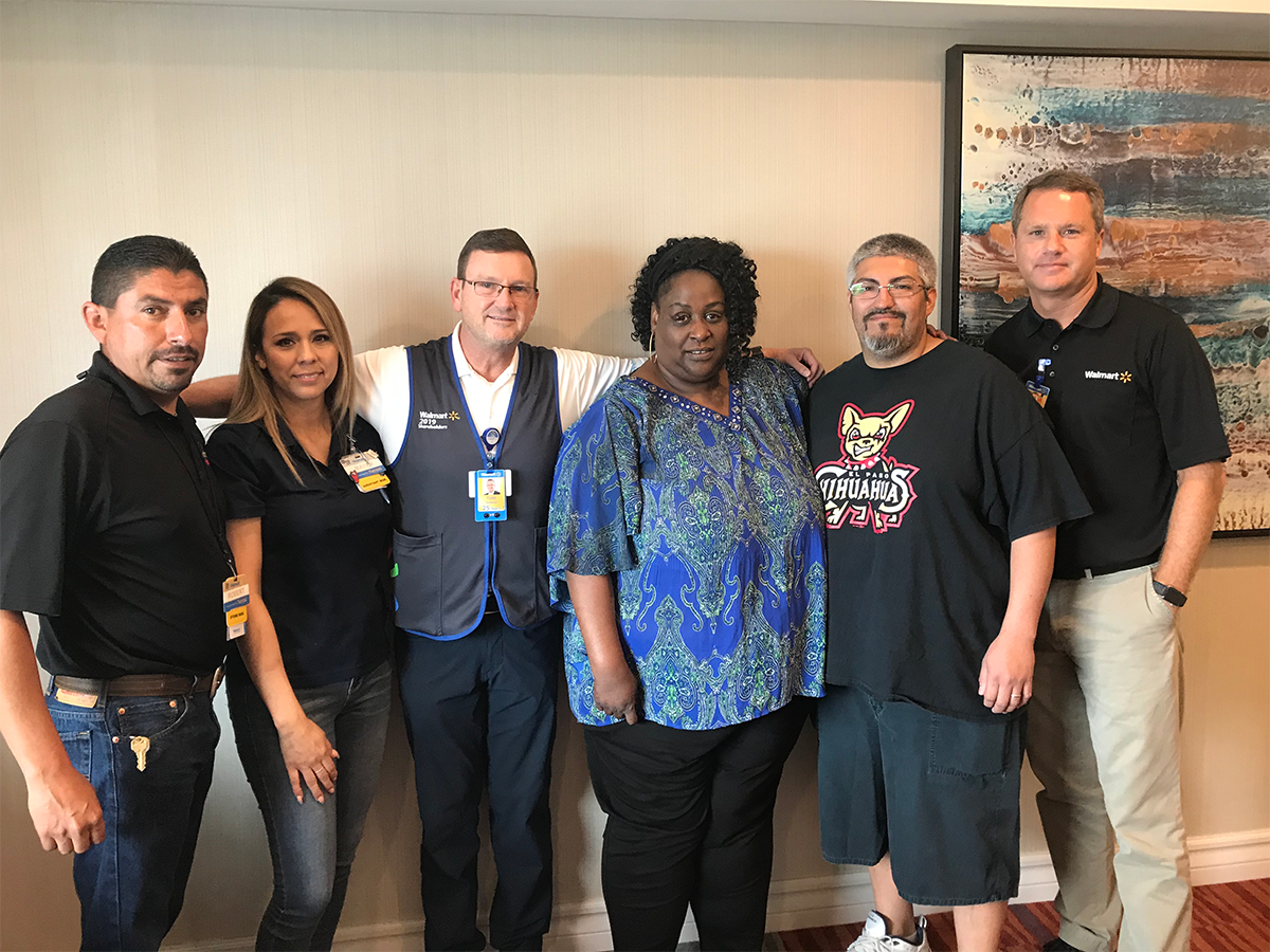 Doug McMillon standing with victims and responders from El Paso tragedy