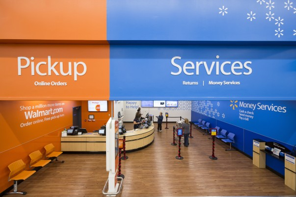 In-store pickup and Walmart services share a space at the front of a Walmart supercenter