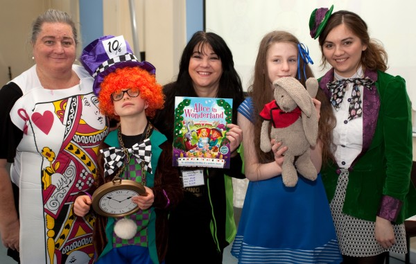 Asda Bristol Patchway community champion Caroline with teachers and pupils for World Book Day at Elmfield School for Deaf Children