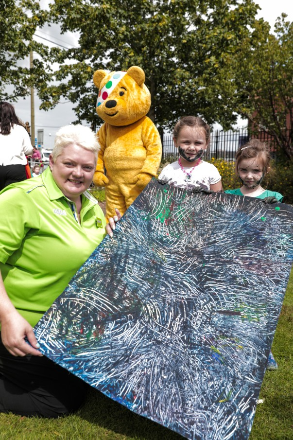 Elaine Livingstone from Asda Portadown joined Pudsey bear to visit the Sticky Fingers youth programme in Newry