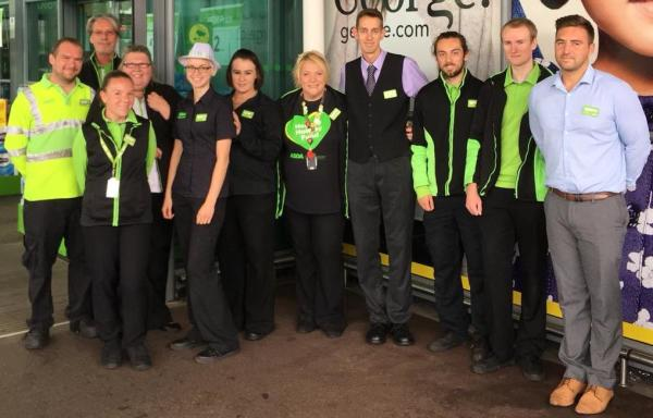 Marathon runner Phil Scott with Asda St Leonards-on-Sea colleagues