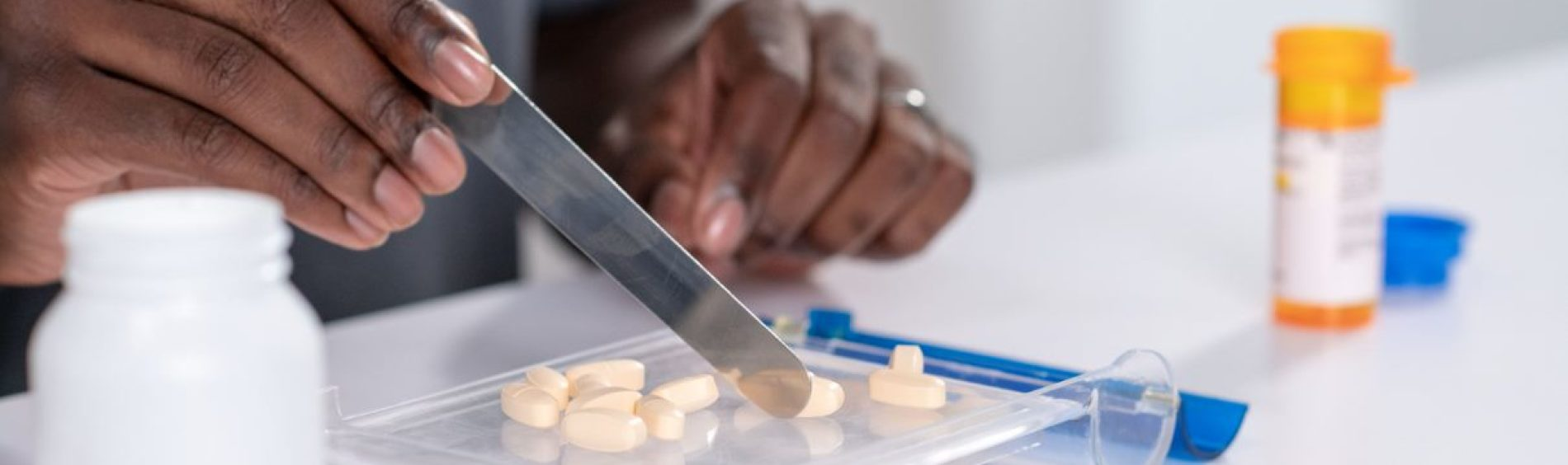 Associate counting out pills on tray
