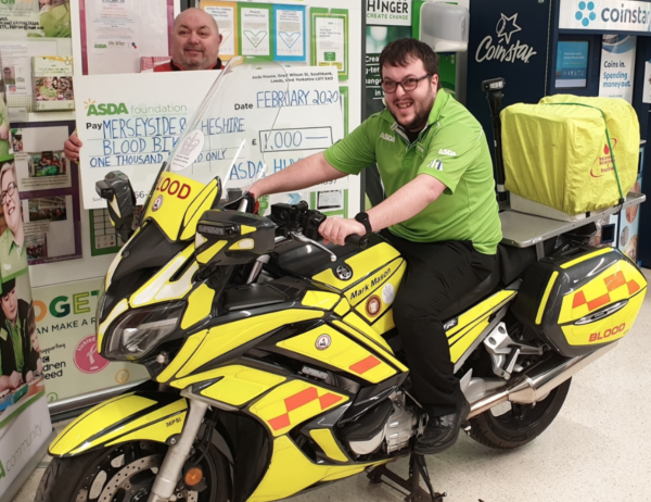 Asda Huyton's community champion Richard presents Merseyside & Cheshire Blood Bikes with an Asda Foundation cheque for £1,000