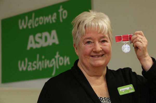 Asda colleague Maureen Wallwork with her British Empire Medal