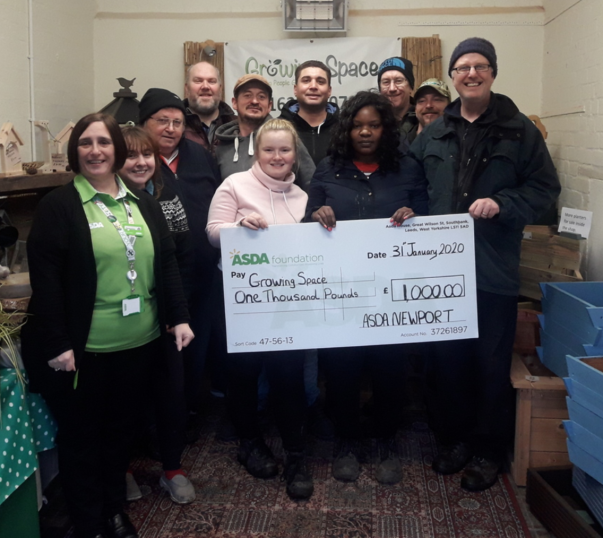 Growing Spaces in Newport receives an Asda Foundation cheque for £1,000 for winning our green token giving scheme.