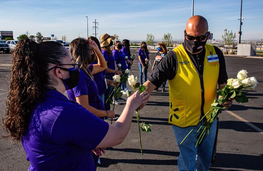 Walmart Associate handing out roses at El Paso Memorial