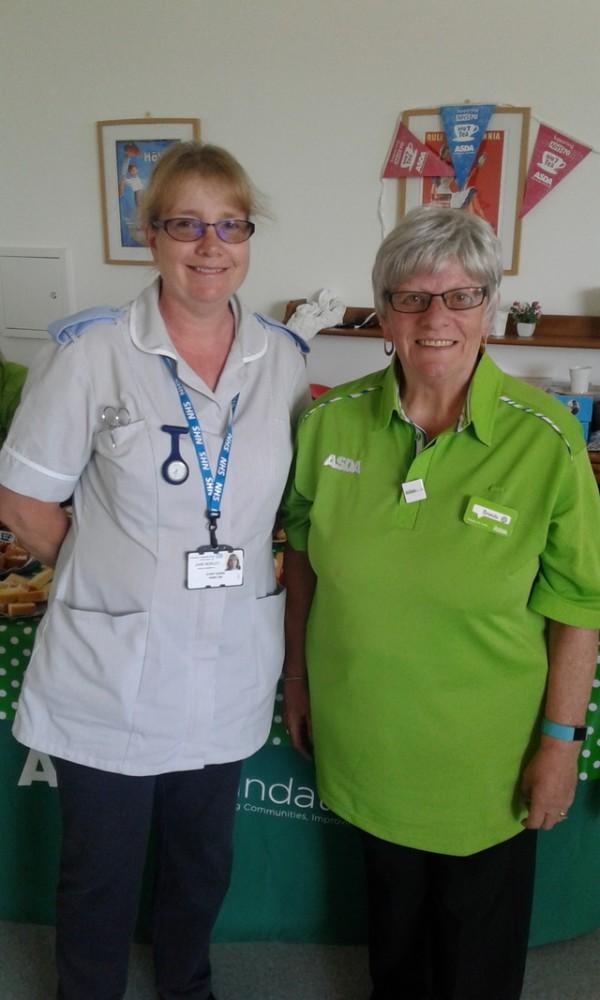 Brenda Wright from Asda Bedminster with staff nurse Jane Morley
