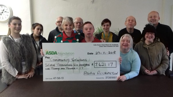 Asda Accrington presented a cheque for £7,000 to Community Solutions North West