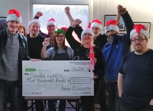 Asda Pilsworth community champion Jill presenting an Asda Foundation cheque