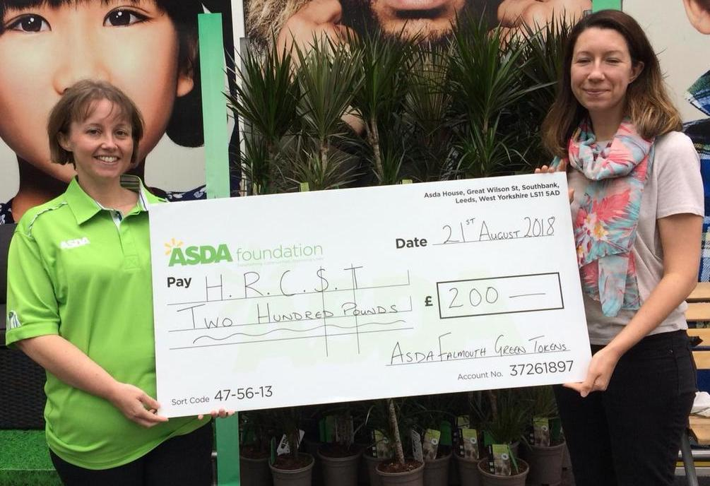 Asda Falmouth community champion Lisa Kirkpatrick presenting a Green Token Giving cheque