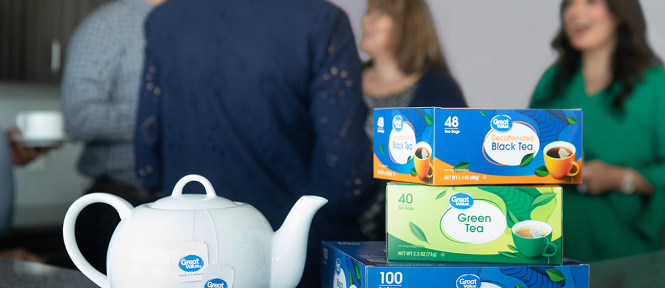 Great Value Tea Boxes with Group of People in Background