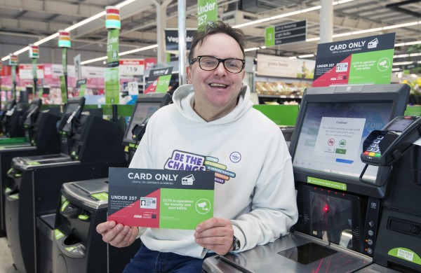 Asda Grangemouth customer David Allen with the redesigned card-only checkout sign