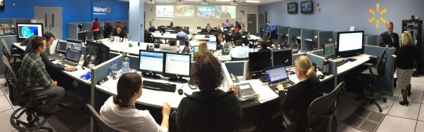Walmart associates fill a room full of computers and screens
