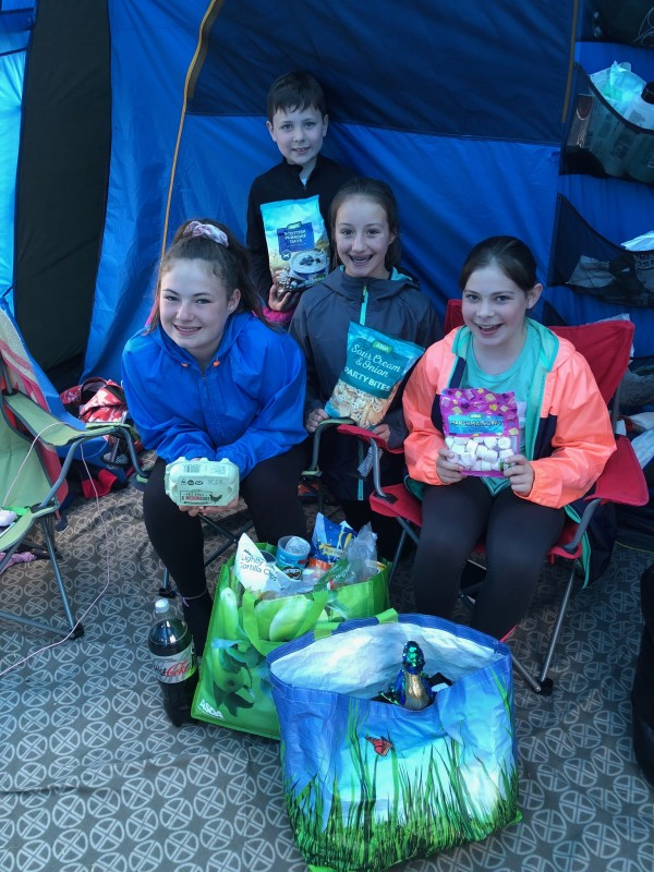 Children with Asda bags of shopping