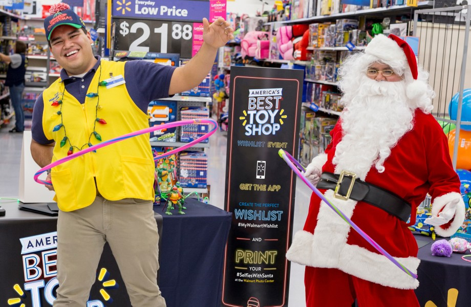 Santa hula hooping with an associate in a Walmart Supercenter