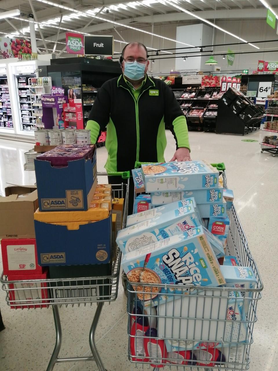 Donation to Newday Church foodbank | Asda Clayton Green