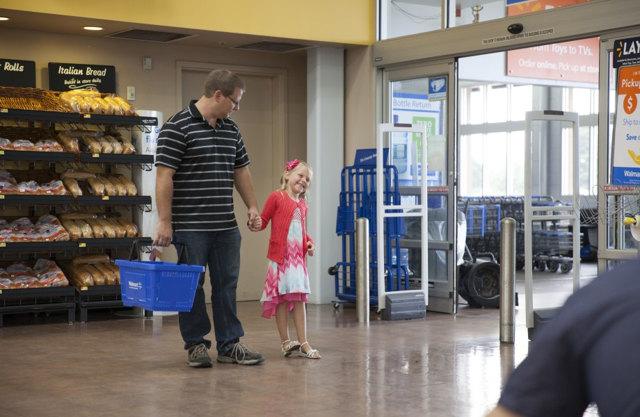 Father and daughter entering Walmart