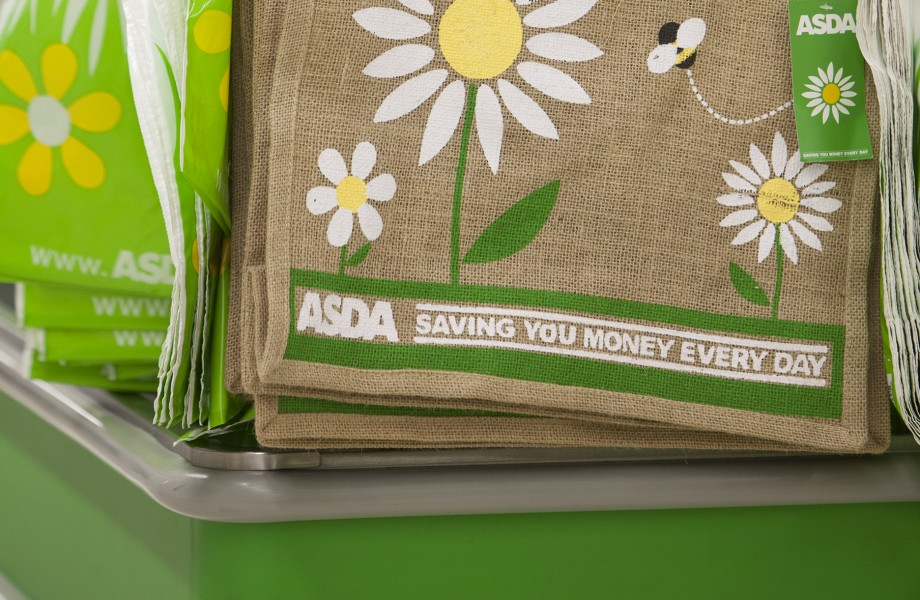 Brown reusable shopping bags with a white and yellow flower pattern are on display