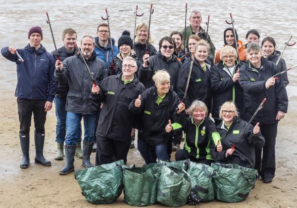 Asda colleagues help to clean West Kirby beach
