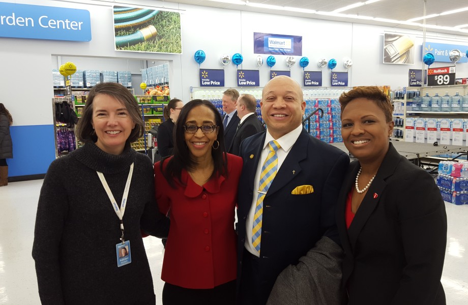 4 Executives stand in a Walmart store