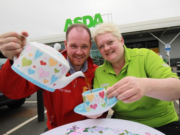Elaine Livingstone from Asda Portadown celebrates the NHS's 70th anniversary with Gareth McGreevy from the Children's Heartbeat Trust