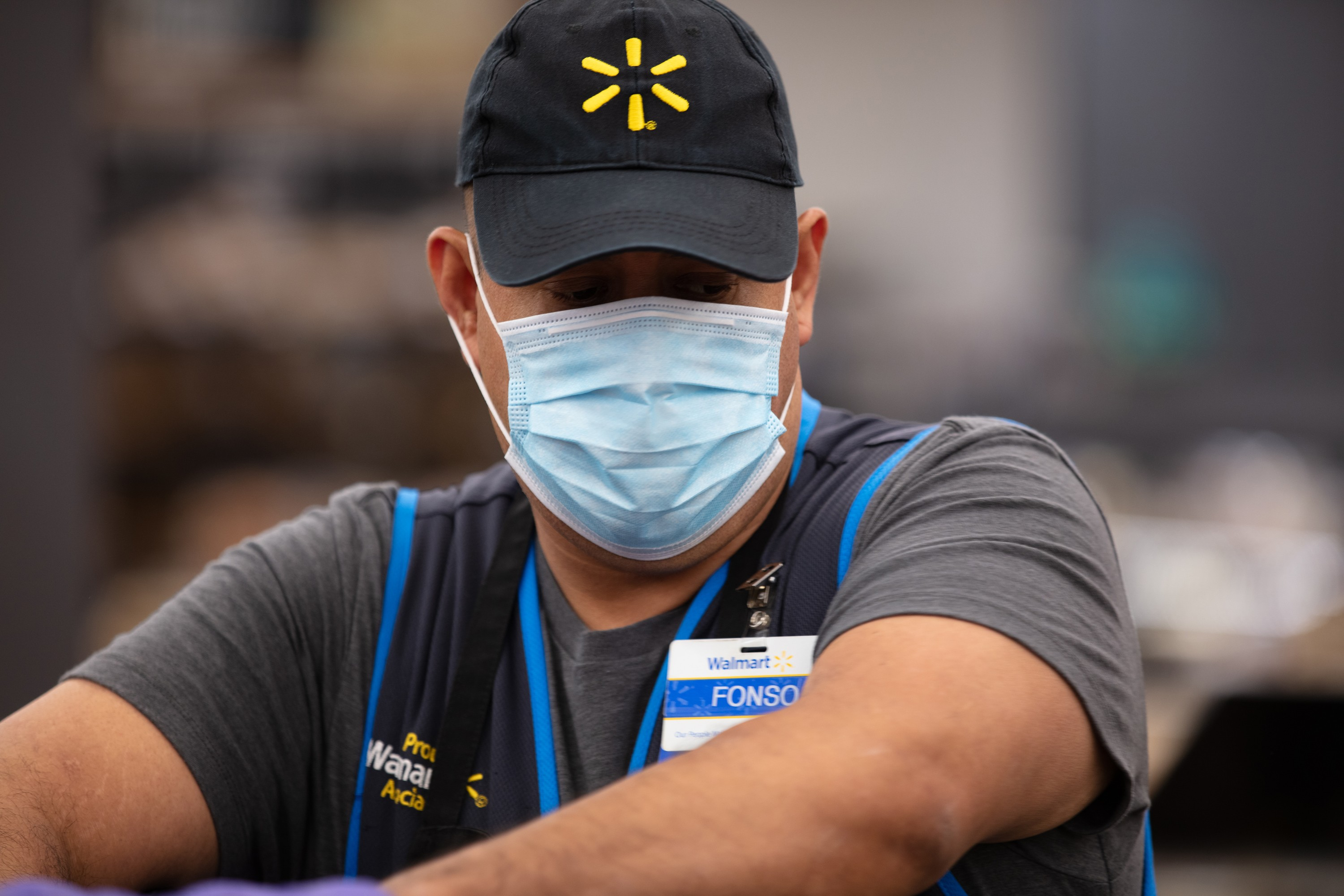 Fonso, a Walmart associate, wears a mask