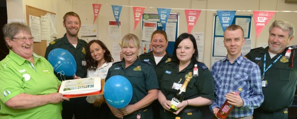 Angie Young from Asda Wheatley celebrates the NHS' 70th anniversary with South Central Ambulance Service