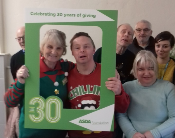 Asda Accrington present an Asda Foundation grant for £7,000 to Community Solutions North West