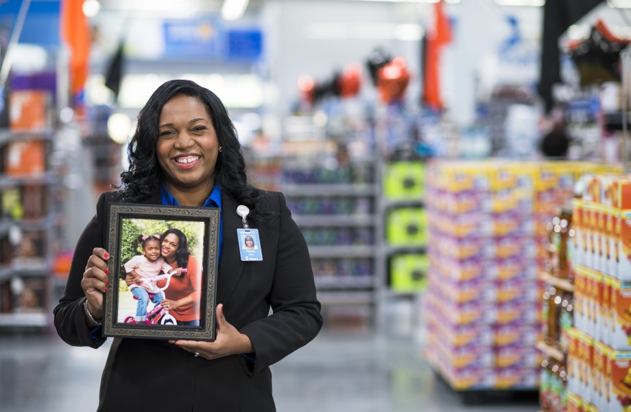 Tracey In Store Holding Photo of Daughter