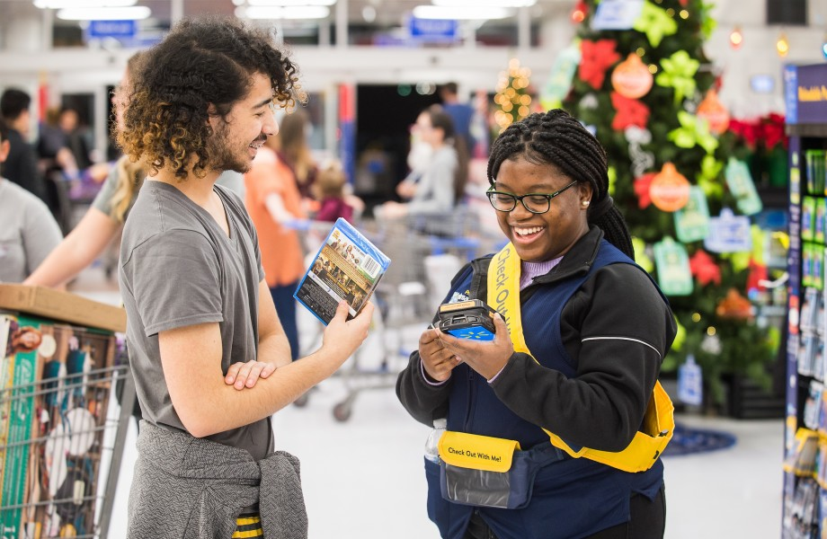 Walmart customer makes a purchase with a Check Out With Me Associate on Thursday, Nov. 22, 2018 in Bentonville, Ark.