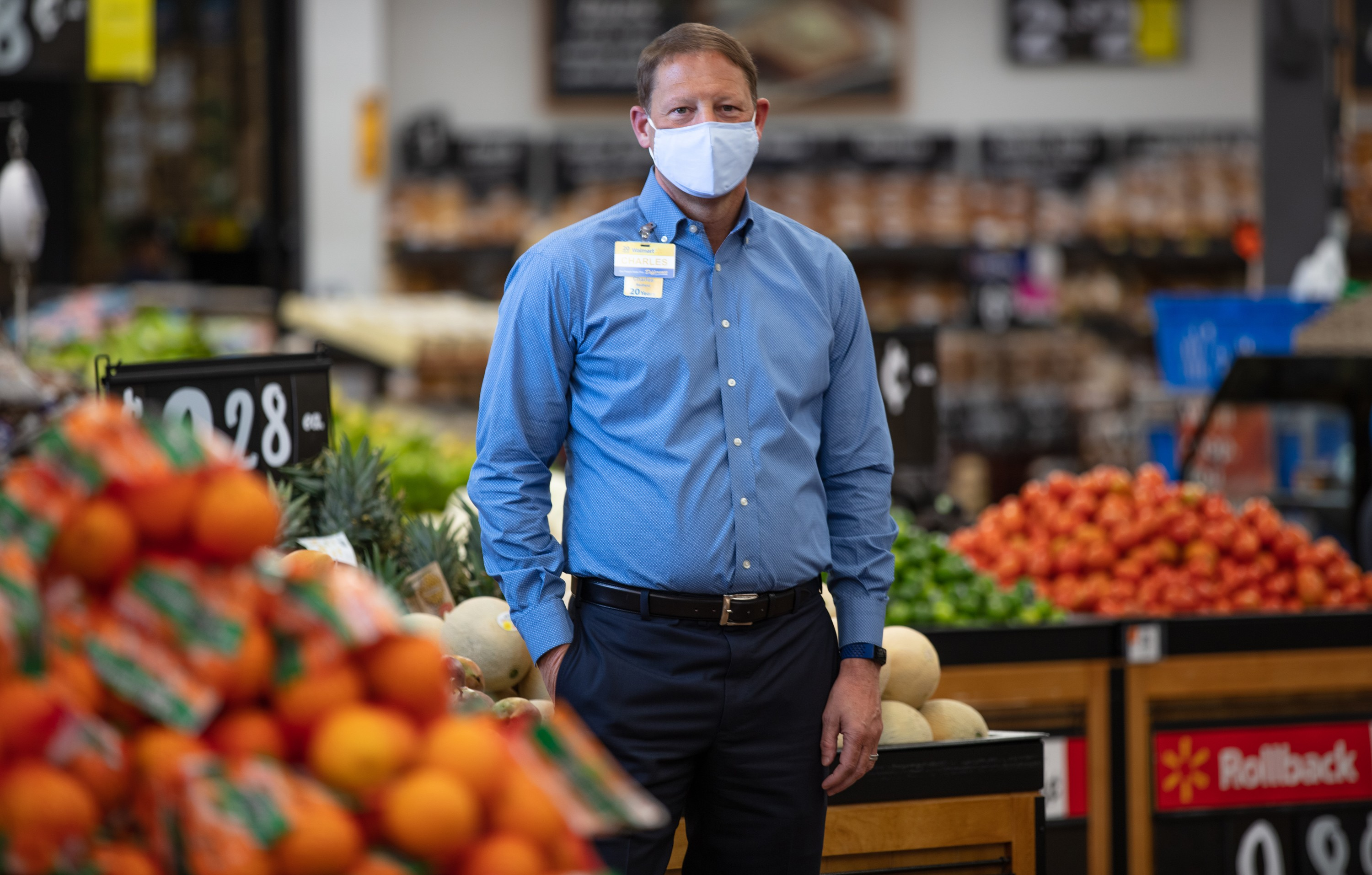 Charles Redfield, executive vice president of food for Walmart U.S., wears a mask in the fresh department