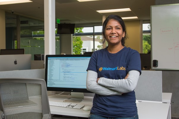 Walmart Labs tech associate Shipraa Manoharan stands by her computer