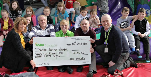 Former Asda Coleraine community champion Sheila Palmer with an Asda Foundation cheque for Building Ballysally Together