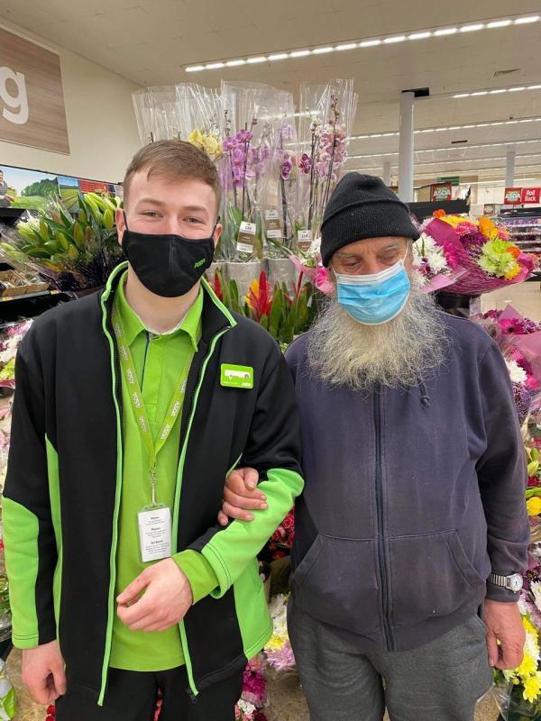 Kieran O'Rourke from Asda Strelley and blind customer Michael Fuller