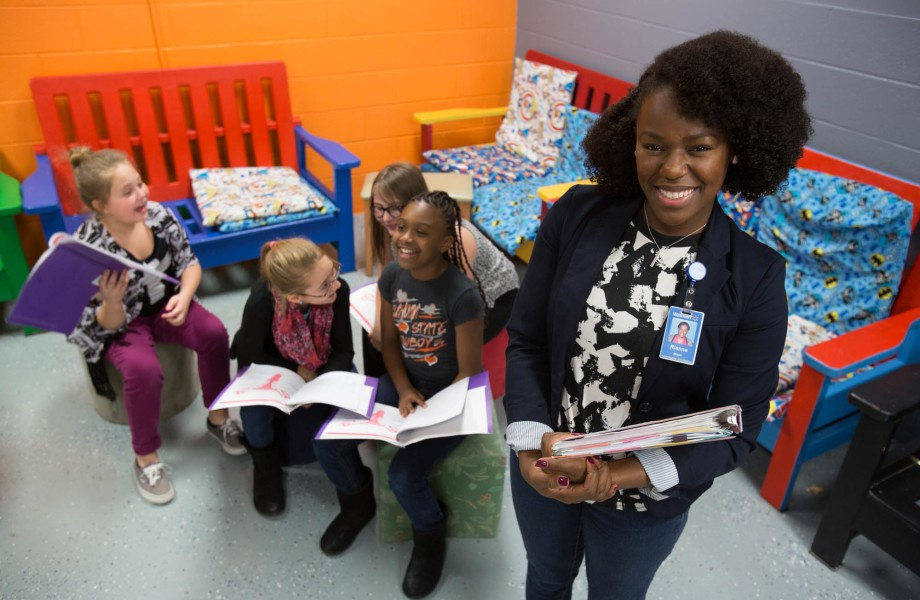 Associate Rianne Dixon spending time with young girls she mentors