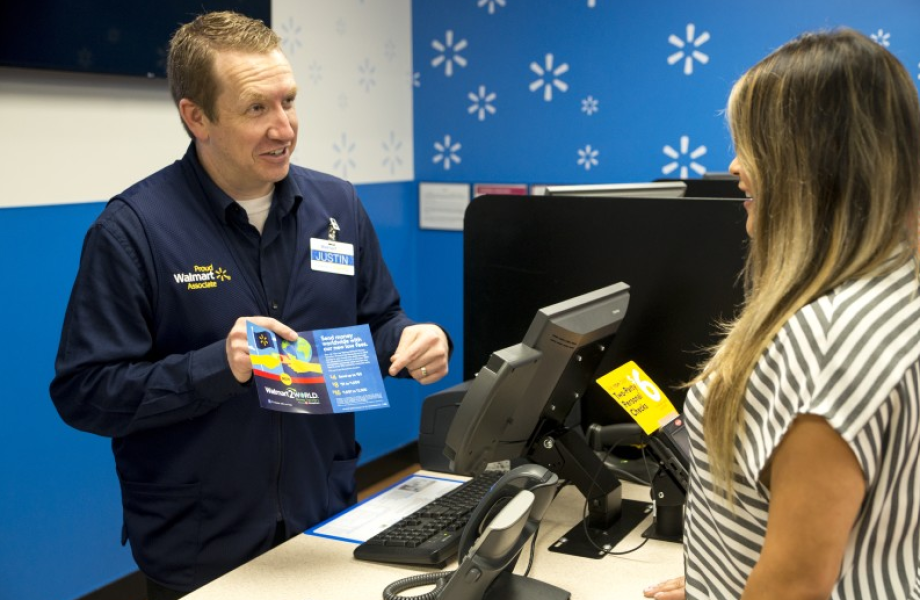 Associate in the money services area assists a customer with a Walmart2World money transfer-crop
