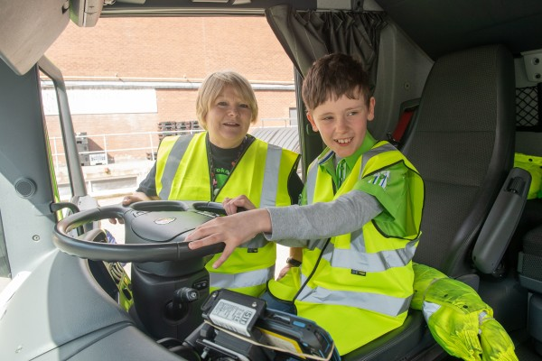 Aaron in a lorry at Asda Falkirk with community champion Margaret Bradie