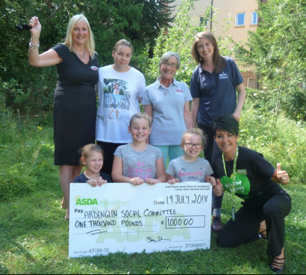 Elizabeth Arbuckle from Asda Toryglen presents Ardenglen Social Committee with £1,000 as part of the Asda Healthy Holiday Fund