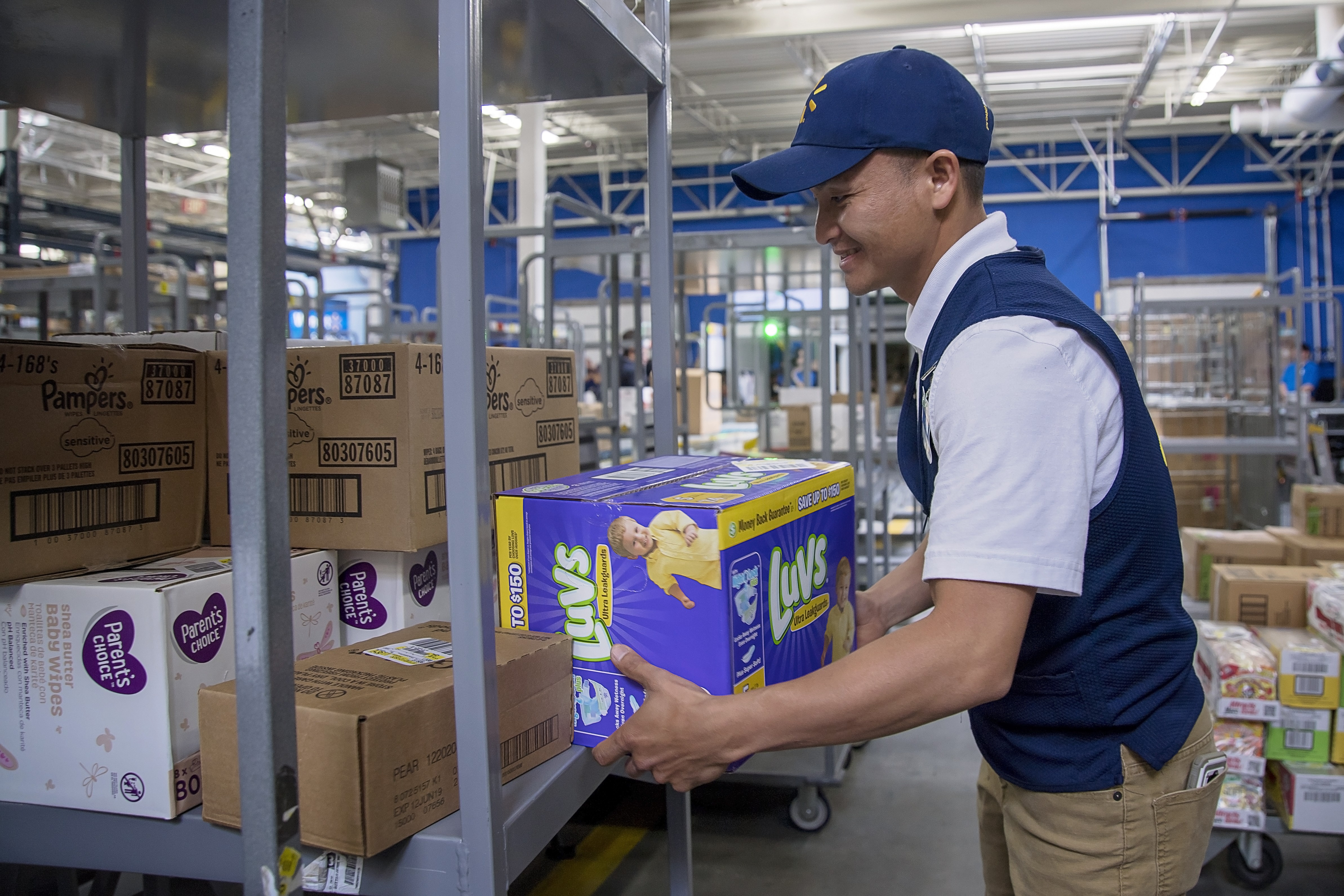 An associate unloads boxes using the new FAST unloading process