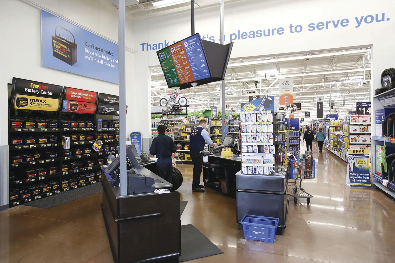 Digital menu boards and service signage in a Walmart automotive area