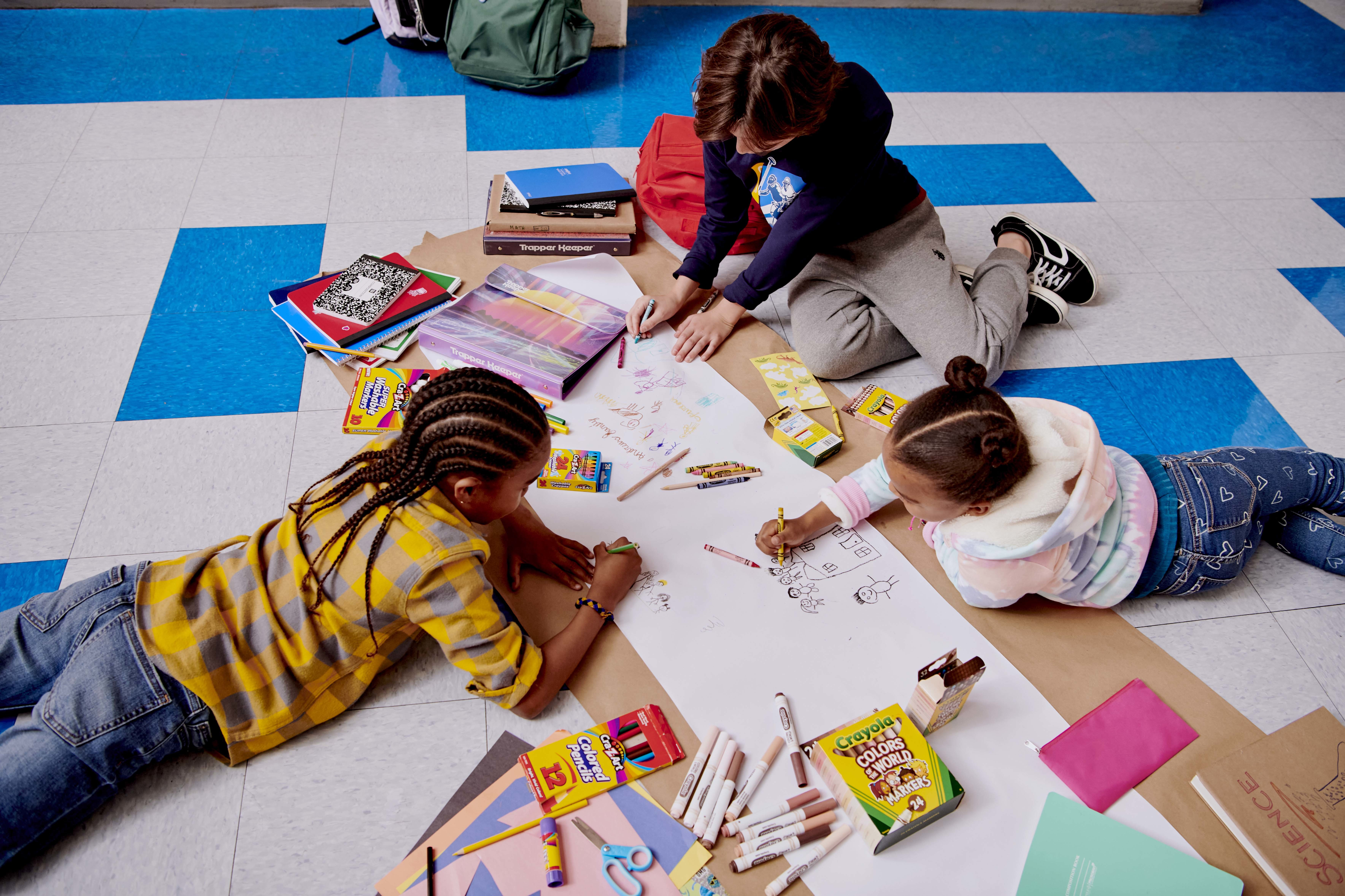 Above view of kids doing artwork