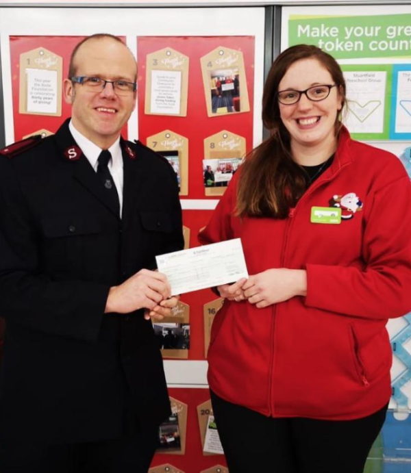 Zoe Scarisbrick from Asda Peterhead presents a Christmas grant to the Salvation Army
