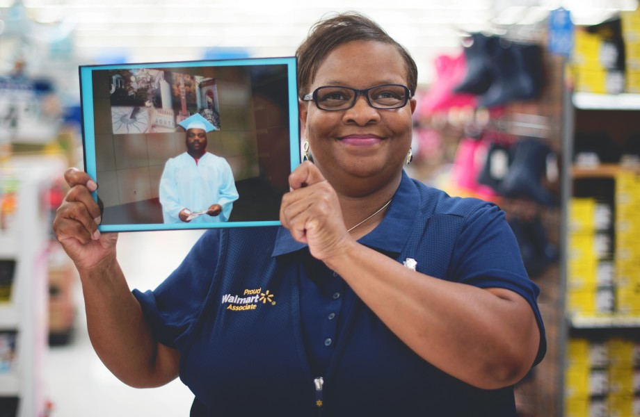 Photo of associate Lisa Moore holding picture of her son