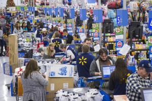 Customers wrap up their holiday shopping during Walmart's Black Friday