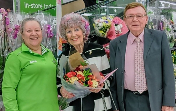Customers Betty and Maurice Curtis celebrate their 68th wedding anniversary with Asda Weymouth community champion Jacqui Dixon