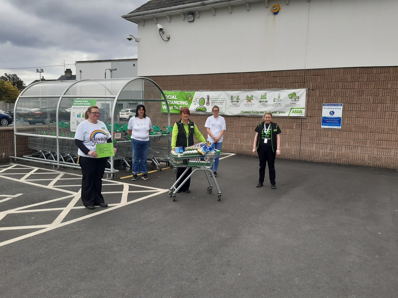 Volunteers from the Friends of Southern Area Hospice collecting a donation for juice cartons from Asda Kilkeel .  | Asda Kilkeel