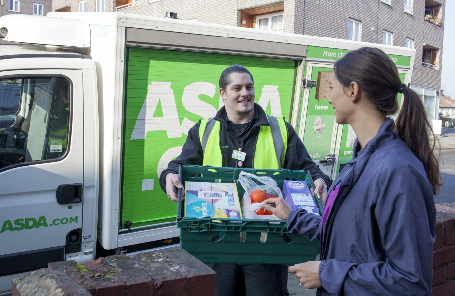 An ASDA.com colleague delivers an order to a customer's home