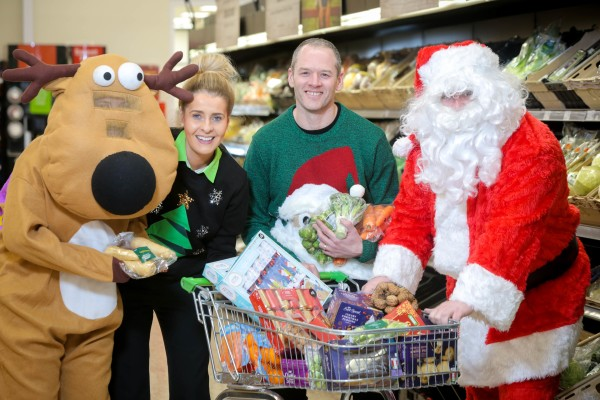 Colleen from Asda Omagh hands over supplies