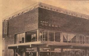 Black and white image of a tall brick building from a newspaper