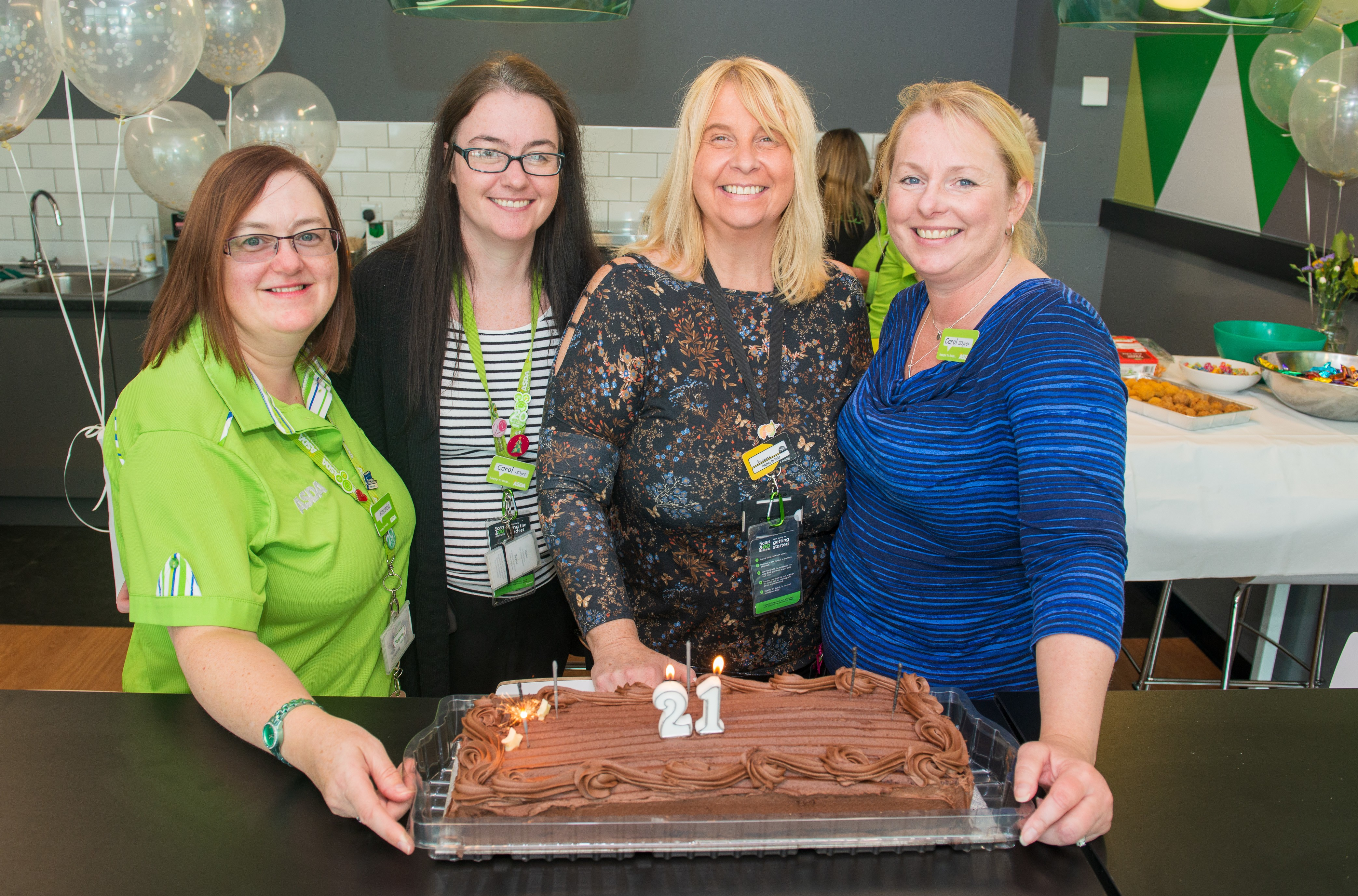 Long-serving colleagues at Asda Kilmarnock celebrate the store's 21st birthday